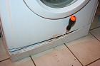 Apertura paratia filtro lavatrice
