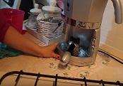 Pulizia braccetto filtro caffè